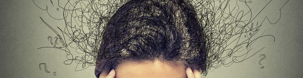 Top of woman's head surrounded by scribbles and question marks