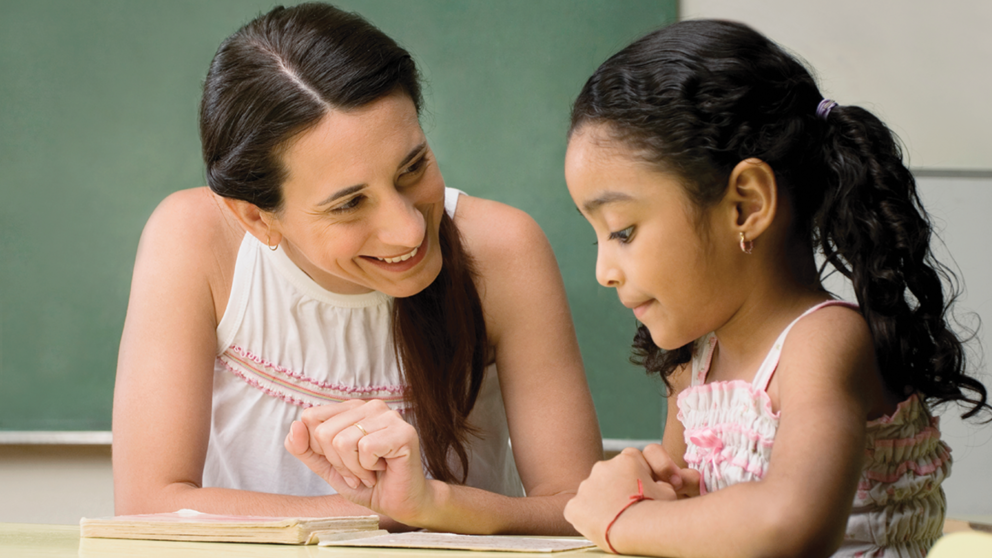A counselor works with a child