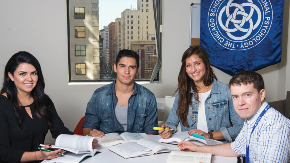 Psychology Master's students study at a table