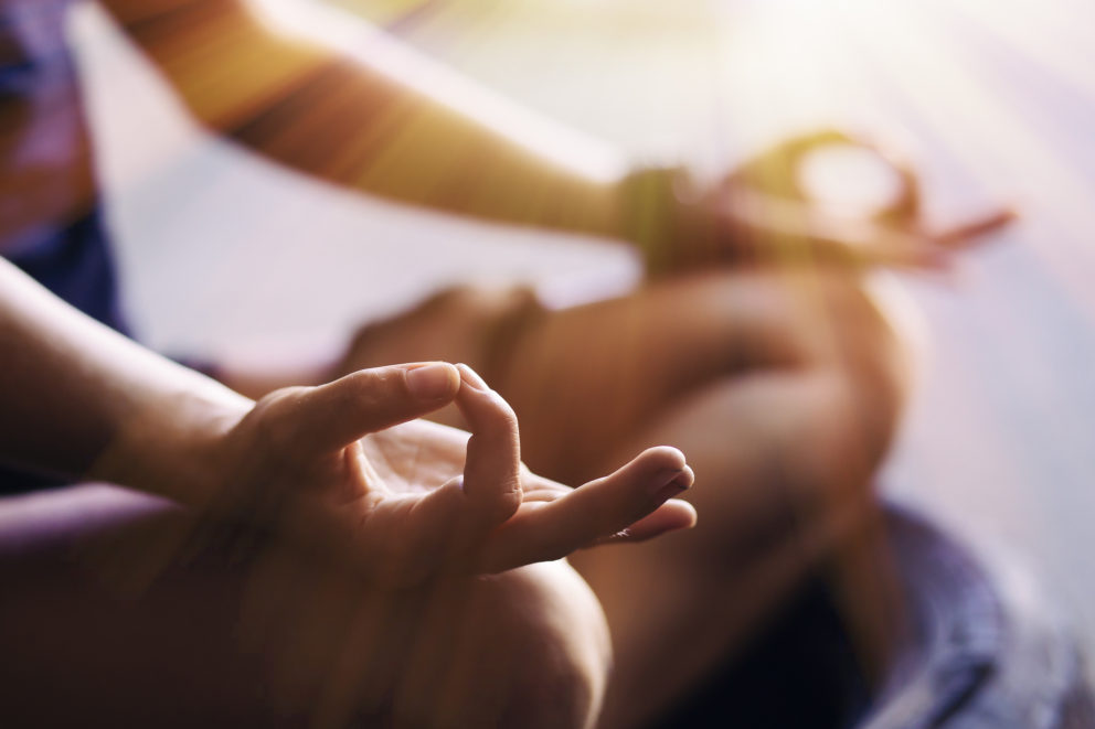 Woman's hands in meditating position