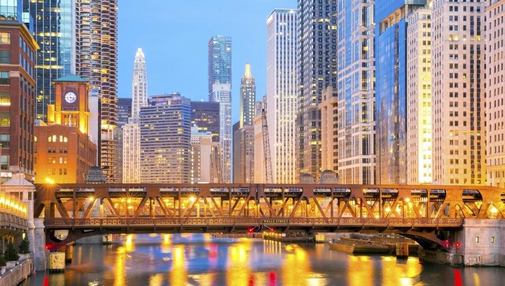 Chicago bridge at sunset with city lights