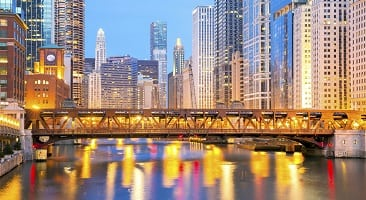Chicago bridge at sunset with city lights