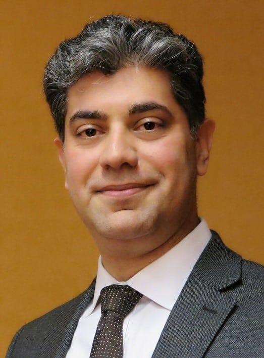 Dr Peyman Raoofi smiling headshot